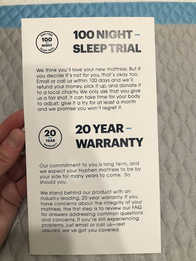 CLose up of the warranty card that ships with the mattress. Hyphen offers a 20 year limited warranty