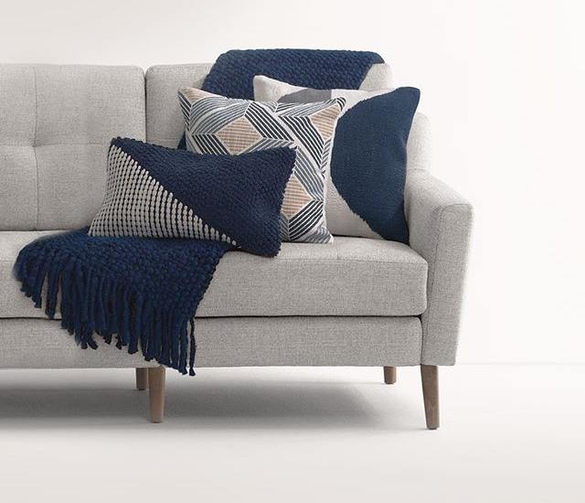 Burrow Pillows with a modern flair, blue, gold and white with patterns and shapes and modern lines