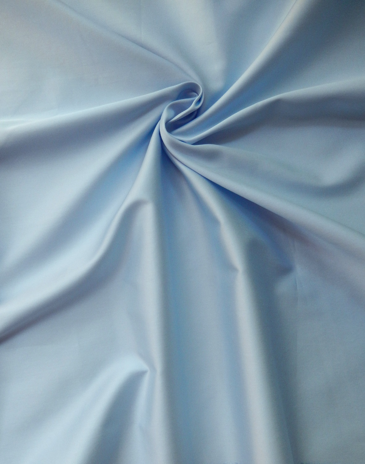 giza cotton sheets blue on a bed